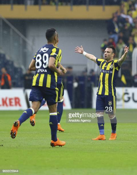 Valbuena and Josef de Souza of Fenerbahce celebrate after a goal during Turkish Super Lig soccer match between Fenerbahce and Bursaspor at Ulker...