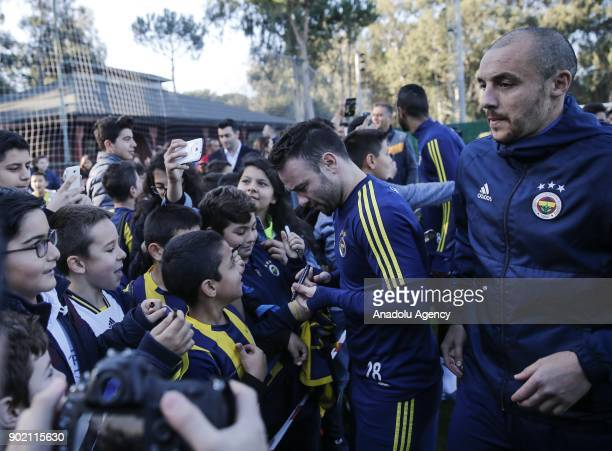 Valbuena of Fenerbahce signs the students' jerseys during the training session within the team's midseason training camp in Antalya Turkey on January...