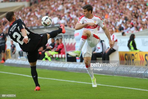 Valdet Rama of Wuerzburger Kickers and Emiliano Adrian Insua Zapata of Stuttgart battle for the ball during the Second Bundesliga match between VfB...
