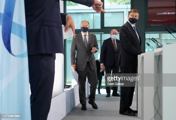 Valdis Dombrovskis , Executive Vice President of the European Commission, Olaf Scholz , German Finance Minister, and Luis de Guindos , Vice President...