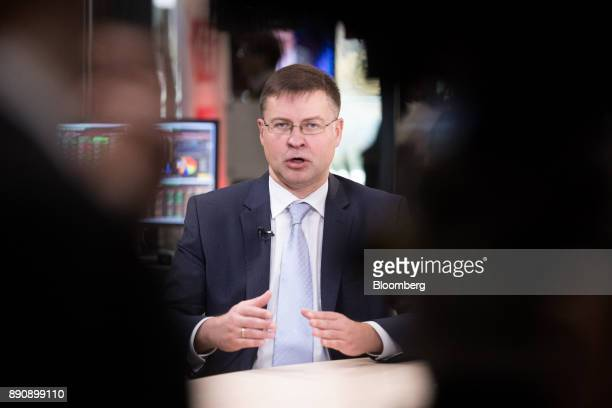 Valdis Dombrovskis vice president of the European Commission gestures while speaking during a Bloomberg Television interview at the One Planet Summit...