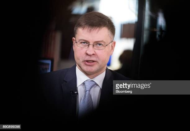 Valdis Dombrovskis vice president of the European Commission speaks during a Bloomberg Television interview at the One Planet Summit in Paris France...