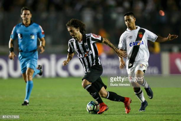 Valdivia of Atletico MG fights for the ball with Yago Pikachu of Vasco during a match between Vasco da Gama and Atletico MG as part of Brasileirao...