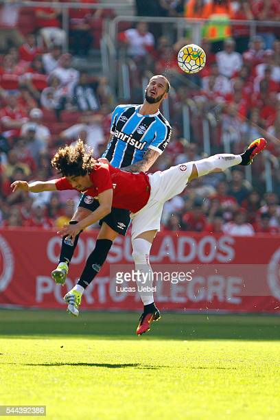 Valdivia of Internacional battles for the ball against Fred of Gremio during the match between Internacional and Gremio as part of Brasileirao Series...