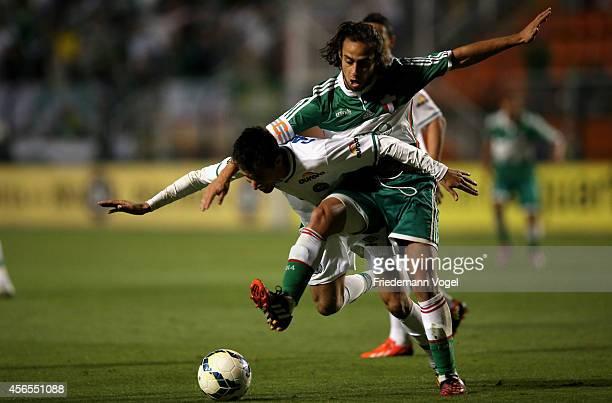 Valdivia of Palmeiras fights for the ball with Rodrigo Biro of Chapecoense during the match between Palmeiras and Chapecoense for the Brazilian...