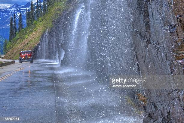 Vale of water from the weeping wall cascades over the garden wall and showers the nostalgic 'Red Bus' that roams the 'going to the sun road'. The...