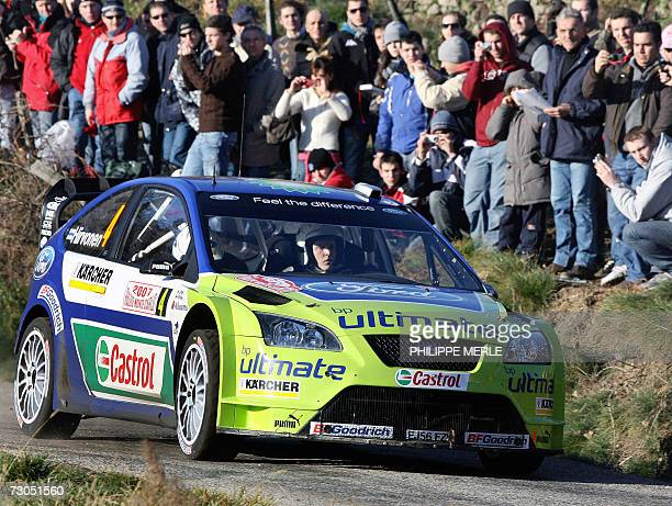 Finland Mikko Hirvonen and his codriver Finland Jarmo Lehtinen steer their Ford Focus RS WRC 06 during the twelth stage of the the MonteCarlo Rally...