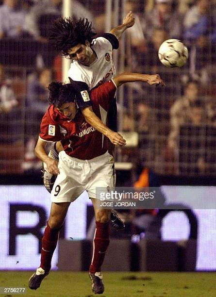 Valencia Argentinian Fabian Ayala vies with Murcia's David Karanka in a Liga match in La Condomina Stadium in Murcia 23 November 2003