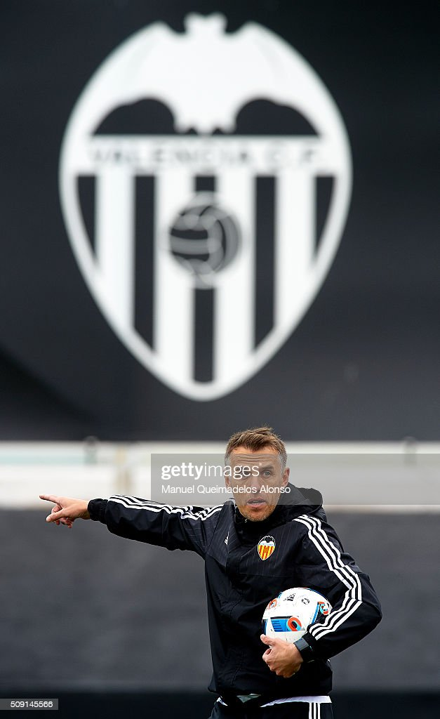 Valencia CF assistant coach Phil Neville gives instructions during a training session ahead of Wednesday's Copa del Rey Semi Final, second leg match between Valencia CF and FC Barcelona at Paterna Training Centre on February 9, 2016 in Valencia, Spain.