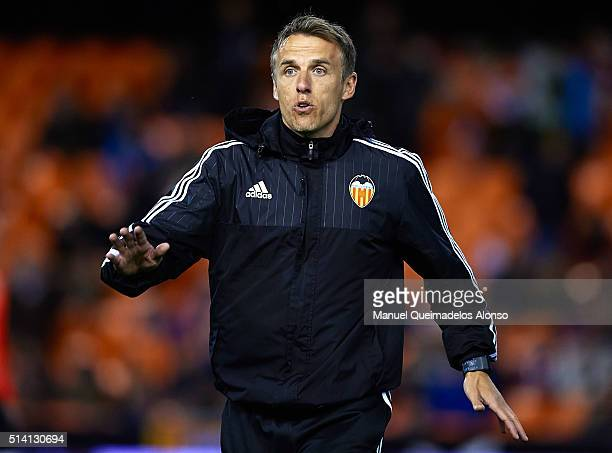 Valencia CF assistant coach Phil Neville gives instructions prior to the La Liga match between Valencia CF and Atletico de Madrid at Estadi de...