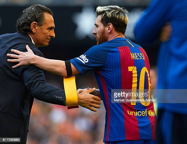 Valencia CF manager Cesare Prandelli greets to Lionel Messi of Barcelona at the end of the La Liga match between Valencia CF and FC Barcelona at...