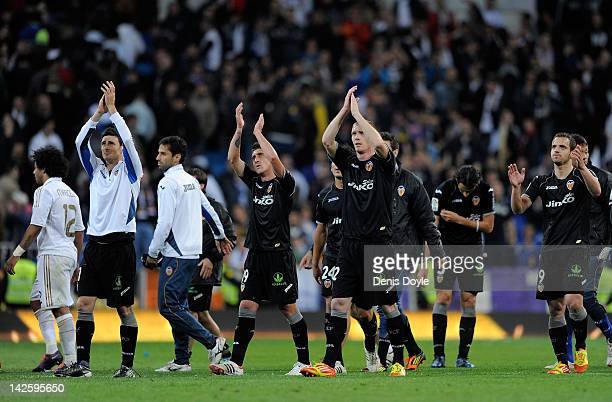 Valencia CF players applaud after they drew 00 during the La Liga match between Real Madrid CF and Valencia CF at Estadio Santiago Bernabeu on April...