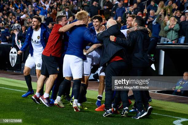 Valencia CF players celebrate their side's third goal during the Copa del Rey Quarter Final match between Valencia CF and Getafe CF at Estadio...