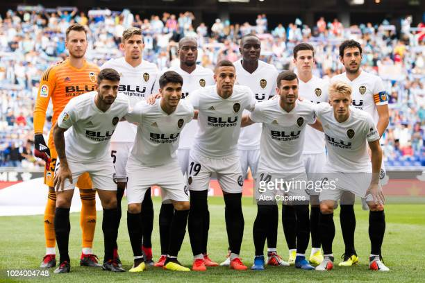 Valencia CF players pose for a team photo before the La Liga match between RCD Espanyol and Valencia CF at RCDE Stadium on August 26 2018 in...