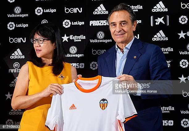 Valencia CF president Lay Hoon Chan and new Valencia CF head coach Cesare Prandelli pose during his presentation at Mestalla stadium on October 3...
