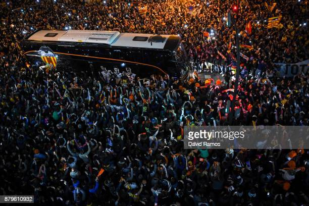 Valencia CF supporters cheer on as the bus team arrives at the stadium during the La Liga match between Valencia and Barcelona at Mestalla stadium on...