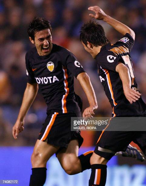 Valencia CF's portuguese Hugo Viana celebrates with teammate after scoring against Deportivo Coruna during their Spanish first League football match...