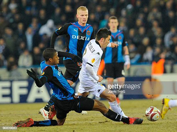 Valencia FC's David Villa vies for the ball with Club Bruges's Ryan Donck during their UEFA Europa League first leg round 32 football match in Bruges...