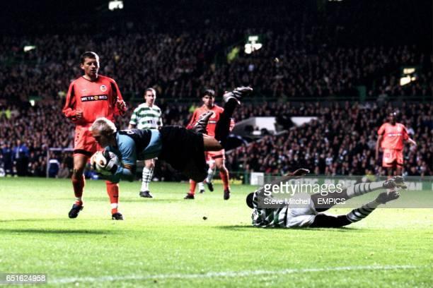 Valencia goalkeeper Santiago Canizares acrobatically collects the ball