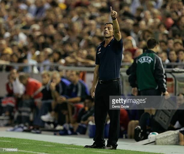 Valencia manager Quique Flores instructs his team during the third qualifying round of the UEFA Champions League match against Salzburg at the...