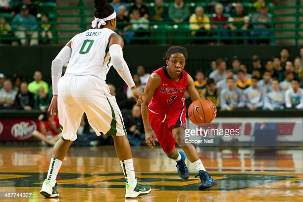 Valencia McFarland of the Mississippi Lady Rebels is defended by Odyssey Sims of the Baylor Bears on December 18 2013 at the Ferrell Center in Waco...