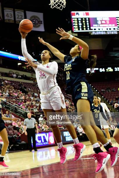 Valencia Myers forward Florida State University Seminoles leans in for two points against Ismini Prapa guard University of Pittsburgh Panthers during...