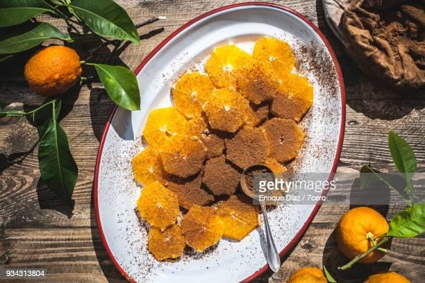 Valencia Oranges, sliced in the sun with cinnamon spice bag