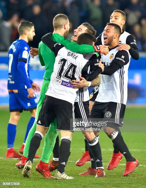 Valencia players celebrate at the end of the Spanish 'Copa del Rey' quarterfinal second leg football match between Deportivo Alaves and Valencia CF...