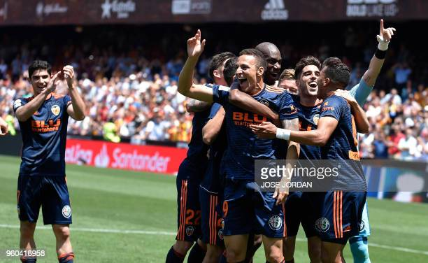 Valencia players celebrate their win at the end of the Spanish league football match between Valencia CF and RC Deportivo de la Coruna at the...