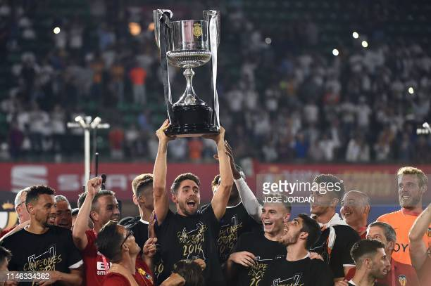 Valencia players celebrate with their trophy after winning the 2019 Spanish Copa del Rey final football match between Barcelona and Valencia on May...