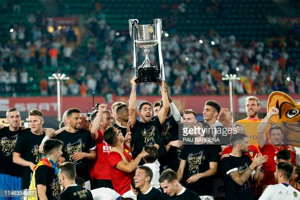 Valencia players celebrate with their trophy after winning the 2019 Spanish Copa del Rey final football match against Barcelona at the Benito...