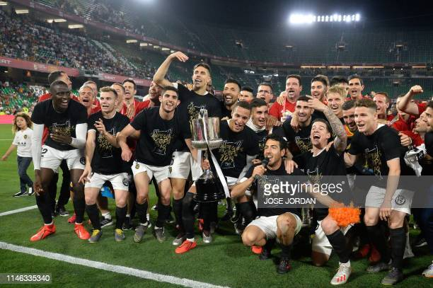 Valencia players celebrate with their trophy fater winning the 2019 Spanish Copa del Rey final football match between Barcelona and Valencia on May...