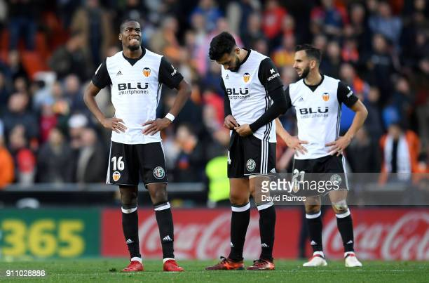 Valencia players look dejected after the La Liga match between Valencia and Real Madrid at Estadio Mestalla on January 27 2018 in Valencia Spain