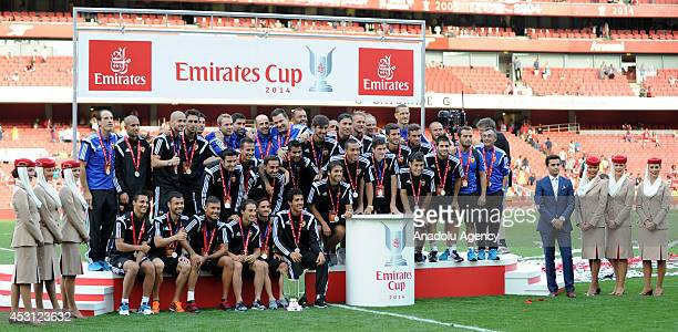 Valencia players pose with the trophy after the Emirates Cup 2014 match between Arsenal and AS Monaco at Emirates Stadium in London England on August...