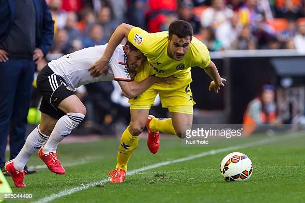 Valencia Spain 11 Pablo Piatti of Valencia CF and 22 Rukavina of Villarreal CF during La Liga match between Valencia CF and Villarreal cf at Mestalla...