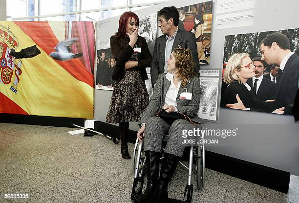 A Spanish victim of the 11 March 2004 terrorist attack in Madrid Laura Jimenez and her father speak with ETA victim Irene Villa during the official...