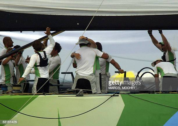 Crew members of Spanish boat Desafio Espanol congratulate each other 26 June 2005 after winning the last leg of the fifth act Louis Vuitton Cup in...