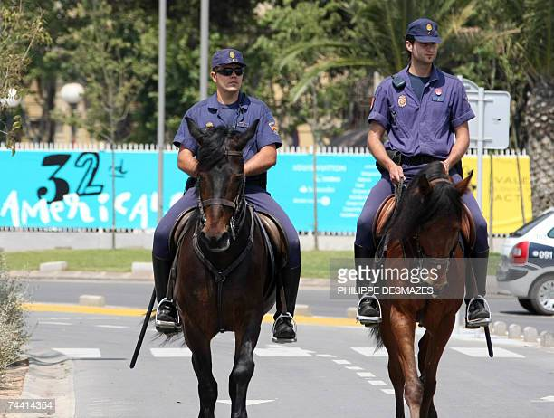 Members of the mounted police walk around the perimeter of the America's Cup harbour in Valencia 06 June 2007 Victory for Emirates Team New Zealand...