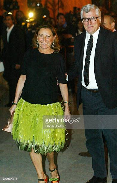 Patrizio Bertelli , chairman of Prada, and his wife designer Miuccia Prada arrive at their company's party celebrated 15 April 2007 in Valencia,...