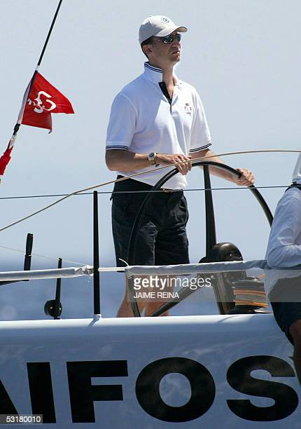 Spain's Prince Felipe steers the boat 'Aifos' as he takes part in the Queen's Cup regatta off the coast of Valencia organised by the Valencia Sailing...