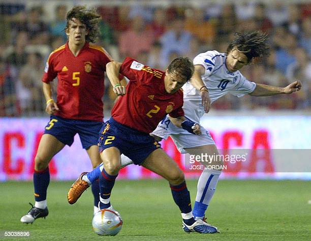 Spaniard Michel Salgado fights for the ball with Bosnian Mirsad Beslija during their football match in a World Cup 2006 qualifier at Mestalla stadium...