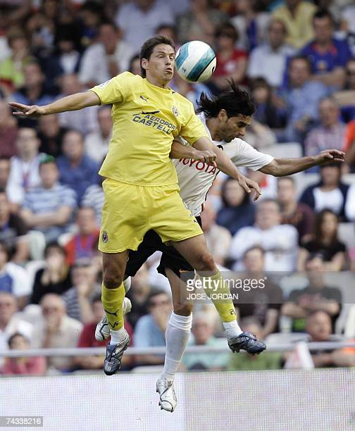 Valencia's Argentinian Fabian Ayala jumps for a header with Villarreal's Mexican Guille Franco during their Spanish league football match at the...