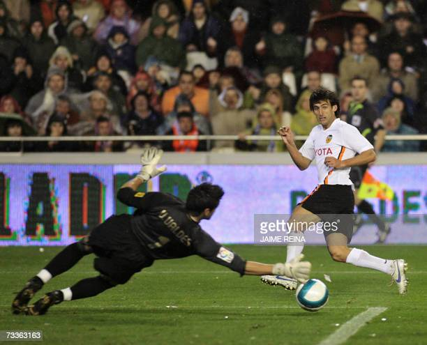 Valencia's Miguel Angel Angulo fights for the ball with Barcelona's goalkeeper Victor Valdes during their Spanish Premier League match at Mestalla...