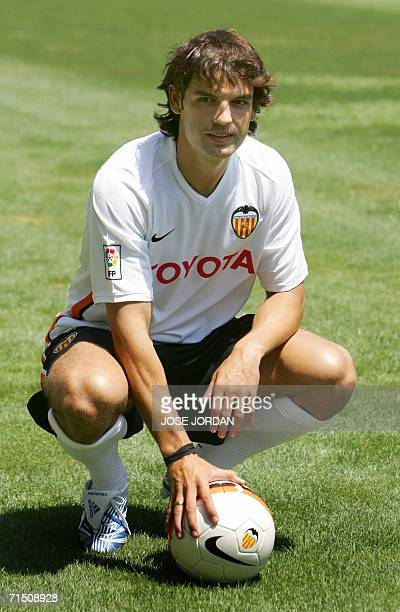 Valencia's new signing Fernando Morientes poses with a ball during his official presentation at the Mestalla Stadium in Valencia 24 July 2006 AFP...