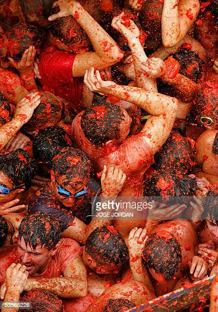 Young people throw tomatoes during the ' Tomatina ' Festival taking place the last wednesday of August in Bunol near Valencia southeastern Spain 31...