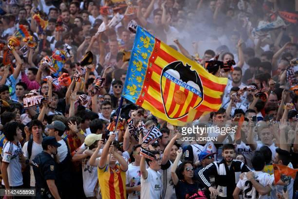 Valencia supporters cheer outside the Mestalla stadium in Valencia ahead of the UEFA Europa League semi-final second leg football match between...
