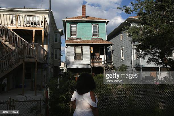 Valencia Terrell looks to an abandoned foreclosed home on August 26 2015 in Atlantic City New Jersey Terrell worked in casino VIP services for years...