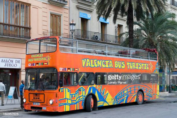Valencia tourist bus parked on road.