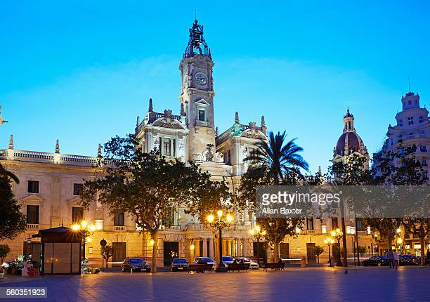 valencia town hall illuminated at dusk - valencia stock pictures, royalty-free photos & images