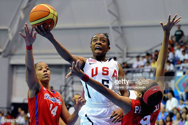 Valencia Treniece McFarland of the USA is challenged by Carla Escalera and Carla Cortijo of Puerto Rico during the Women's Basketball Group A...